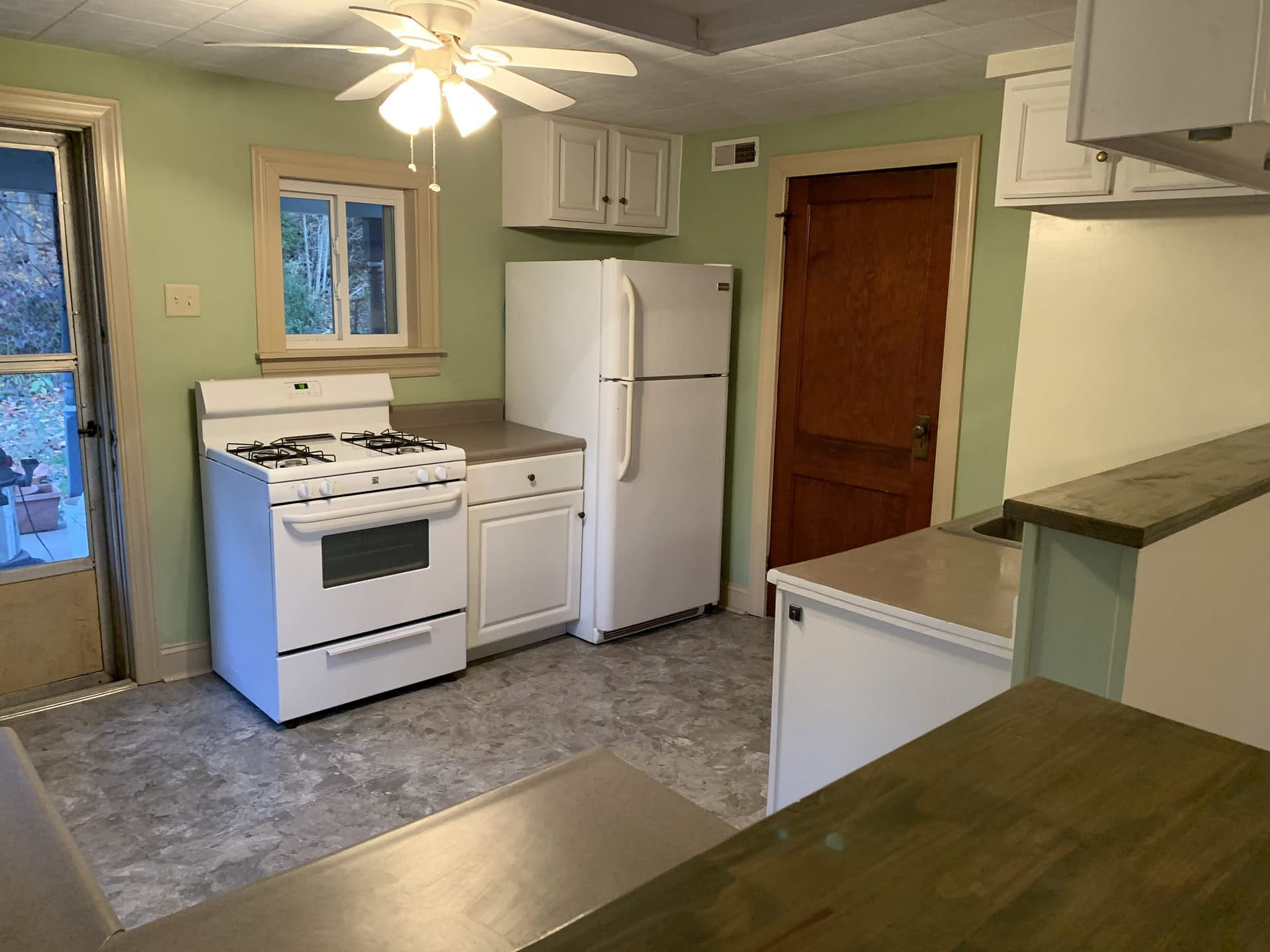 Kitchen view with fridge and stove