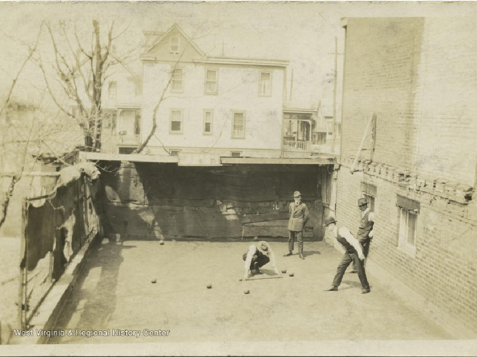 old photo of people playing bacci